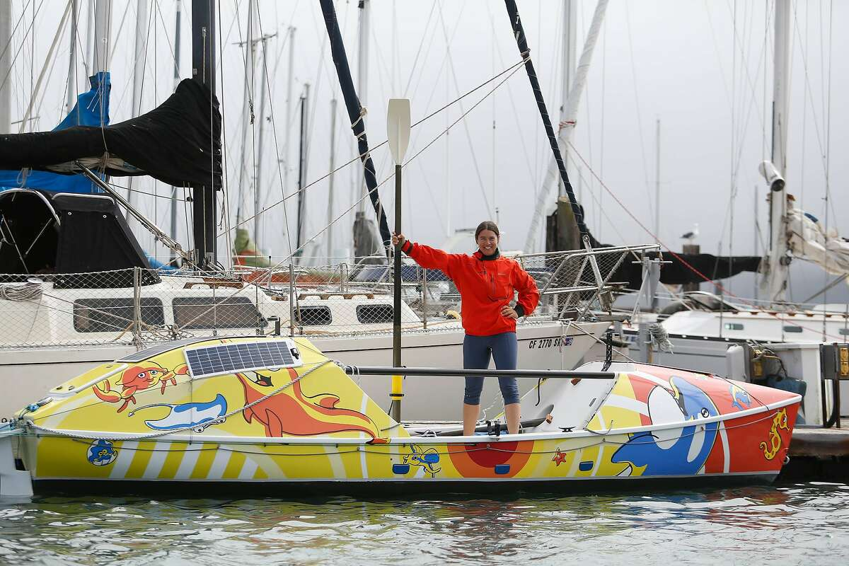 Long-distance ocean rower Lia Ditton stands for a portrait with her boat at Travis Marina on Friday, September 27, 2019 in Sausalito, CA.