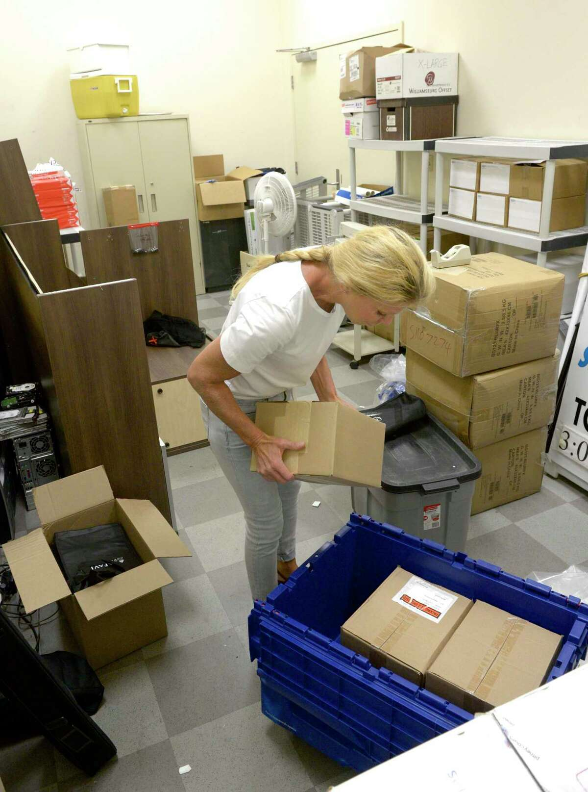 JoAnn Cueva packs up the storage room at the Greater Danbury Chamber of Commerce for their move to new office space at 1 Ives Street. Cueva is Director of Events and Business Development. Thursday, September 26, 2019, in Danbury, Conn.