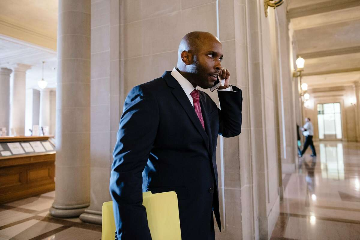 Dr. Anton Nigusse Bland, San Francisco's Director of Mental Health Reform, takes a phone call while walking through City Hall in San Francisco, Calif, on Tuesday, September 3, 2019.