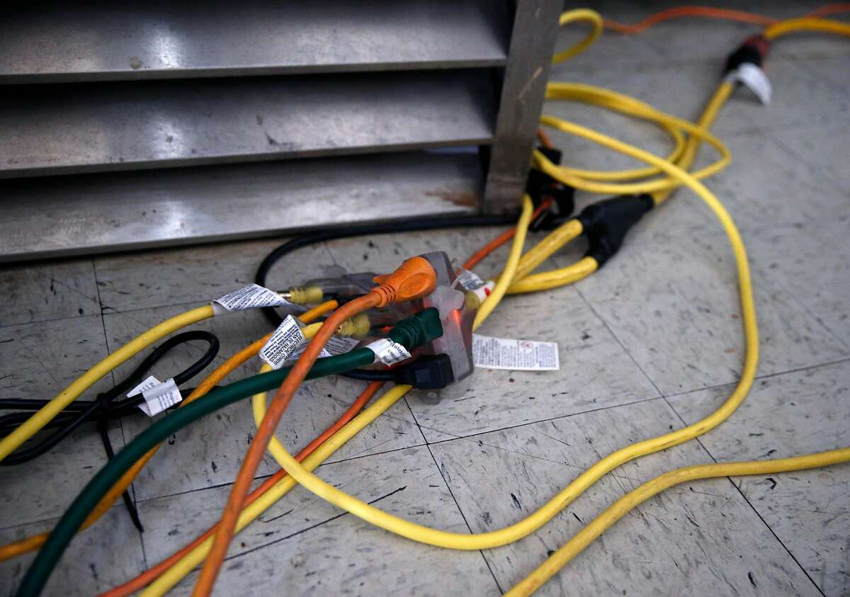 Extension cords connected to a gas-powered generator extend through the Spanish Flat Country Store and Deli in Lake Berryessa, Calif. on Saturday, June 8, 2019. PG&E enabled its public power safety shutoff protocol resulting in outages for 1,600 customers in the area.