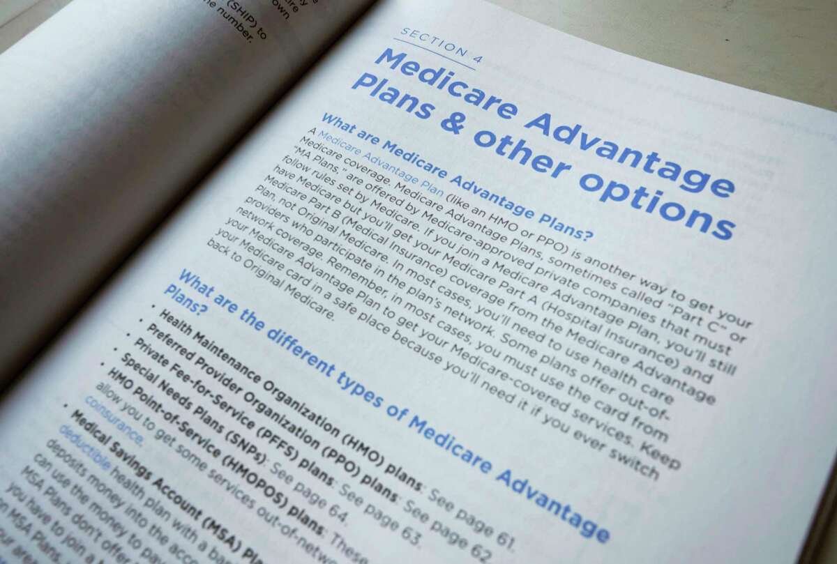FILE - This Nov. 8, 2018 file photo shows a page from the 2019 U.S. Medicare Handbook in Washington. The federal government is giving insurers who offer Medicare Advantage plans more leeway to pay for things theya€™d ordinarily never cover. (AP Photo/Pablo Martinez Monsivais, File)