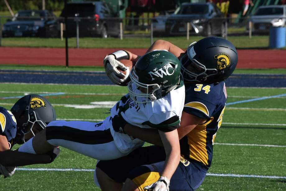 Weston's Tyler Bower makes a tackle against Northwest Catholic at Weston high school on Friday, Sept. 27, 2019. (Pete Paguaga, Heasrt Connecticut Media) Photo: Pete Paguaga / Hearst Connecticut Media / Connecticut Post