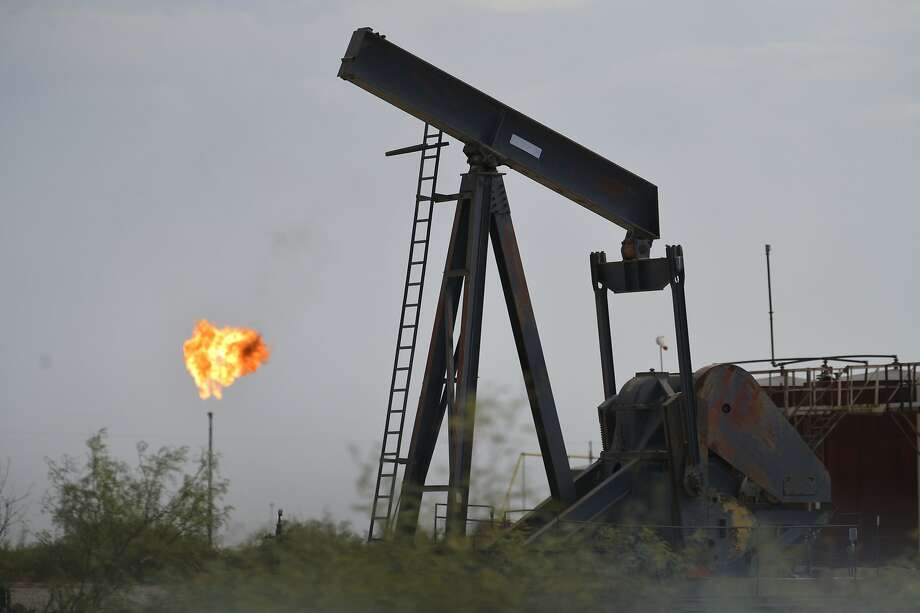 This Sept. 6, 2019 photo shows oil-industry equipment and flares that are common sights in the landscape around Mentone, a sparsely populated town in Loving County in West Texas that is experiencing an oil boom.  Photo: Billy Calzada, Associated Press