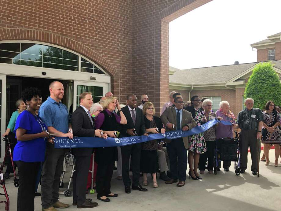 The Buckner Parkway Place community joins together with Houston Mayor Sylvester Turner (center) for a ribbon-cutting ceremony celebrating $12.8 million in renovations to improve its residents' lives. Photo: Tracy Maness