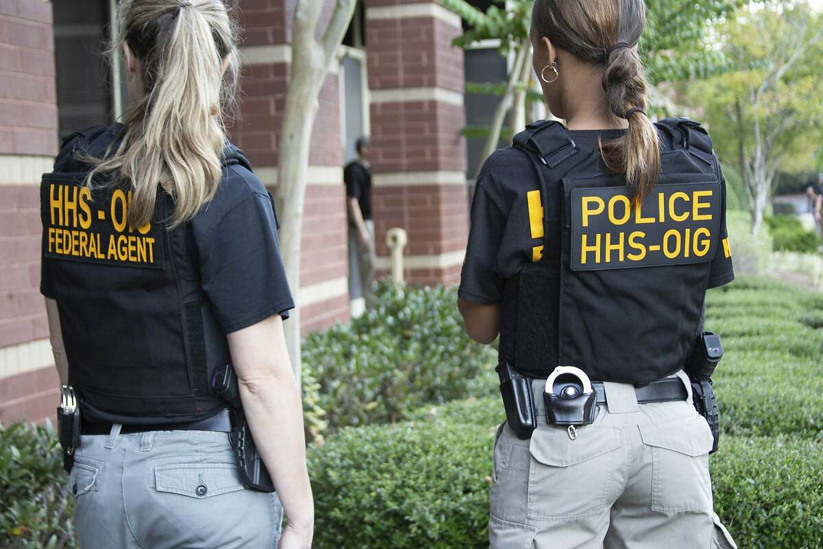 In this photo provided by the Department of Health and Human Services Office of the Inspector General, federal agents from the HHS Office of Inspector General prepare for operations targeting individuals allegedly involved in genetic testing fraud in the Atlanta region, Friday morning, Sept. 27, 2019. Federal law enforcement officials say they've taken down a Medicare fraud scheme that enticed seniors to get their cheeks swabbed for unneeded DNA tests. Friday's