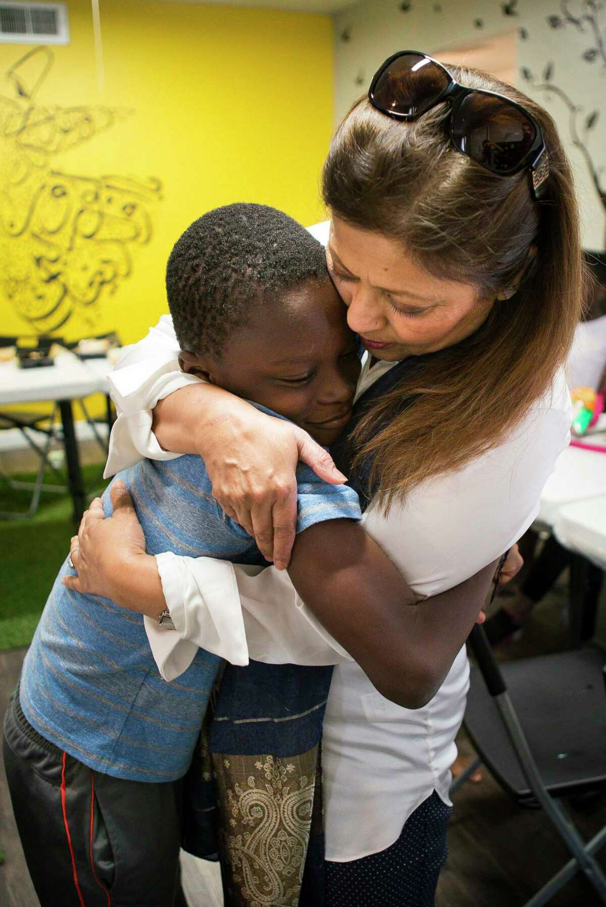 Aisha Siddiqui, the founder of the Houston refugee advocacy group CHAT, receives a hug from Patrick Katta, 9, during a summer camp in Houston in July 2019. CHAT, a non-profit organization founded by Siddiqui to support the health and well-being of Houston's immigrant and refugee community, stands for Culture of Health - Advancing Together. Texas and Houston have long been the country's top destination for refugees