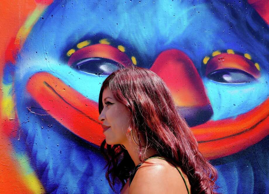 Local artist, Michelle Ruby on Monday, August 19, 2019 stands next to a large wall mural that she painted in Chula Vista.  Ruby was among the artist that were invited to paint the eleven large wall murals along the Bayshore Bikeway along Chula Vista's bay front. (Nelvin C. Cepeda/The San Diego Union-Tribune/TNS) Photo: Nelvin C. Cepeda, MBR / TNS / The San Diego Union-Tribune