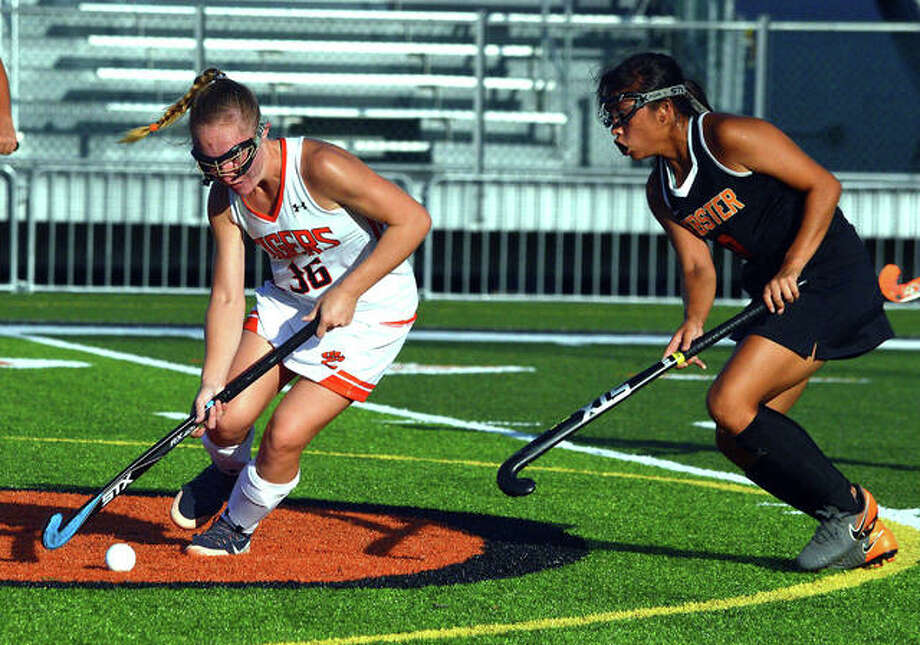 Edwardsville's Mattie Norton, left, controls the ball during Friday's home against Webster Groves. Photo: Scott Marion/The Intelligencer