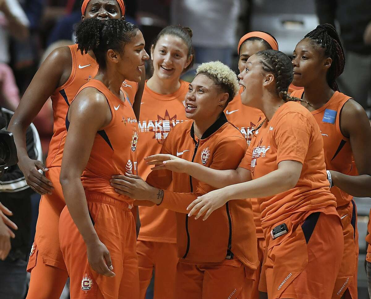 Connecticut Sun's Alyssa Thomas, left, is celebrated by her teammates at the end of a WNBA basketball playoff game against the Los Angeles Sparks, Tuesday, Sept. 17, 2019, in Uncasville, Conn. (AP Photo/Jessica Hill)