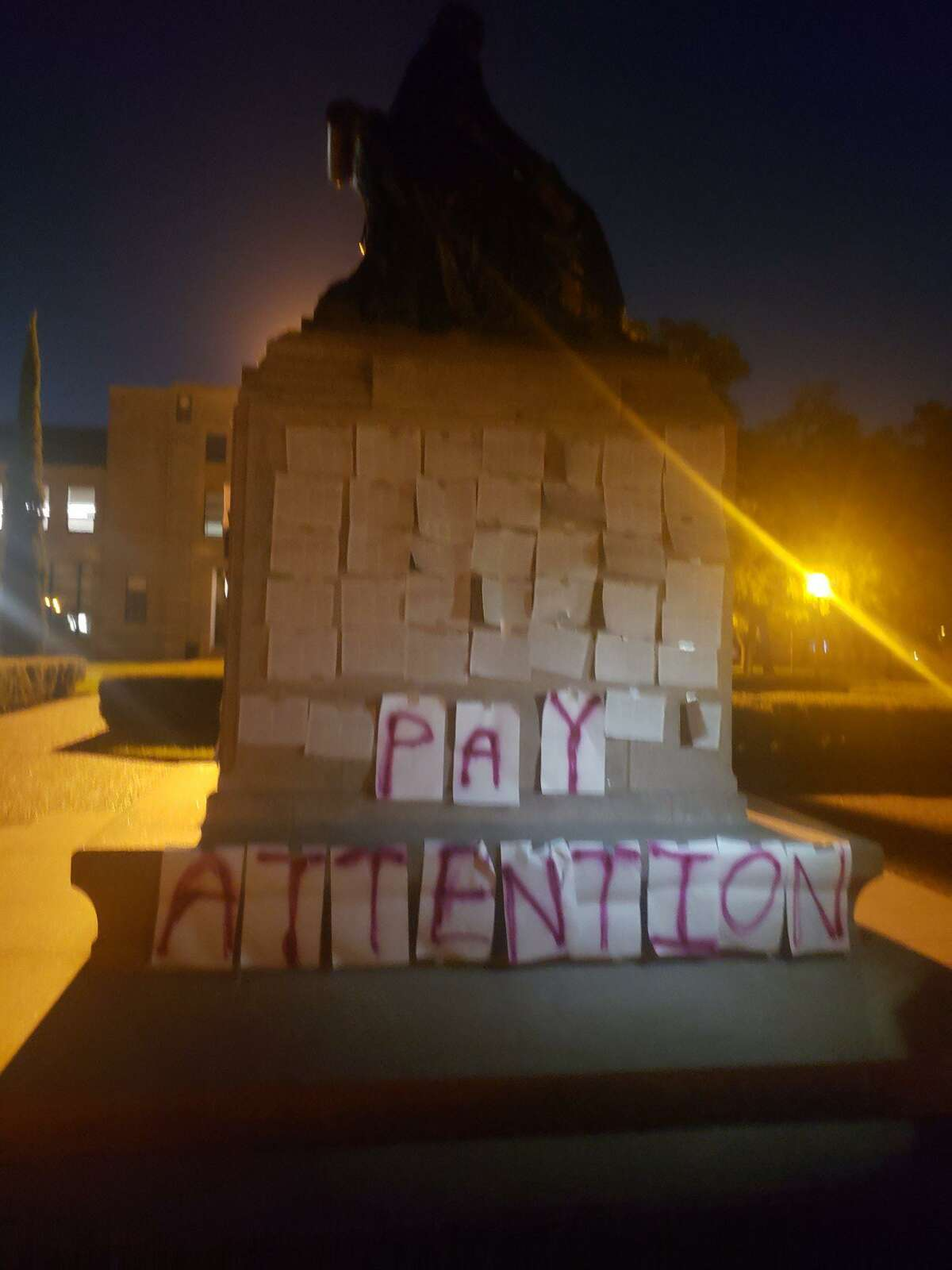 """Several copies of a former Rice University student's op-ed about her sexual assault were posted to the base of an on-campus statue of the college's founder William Marsh Rice on Sept. 26. Beside the display were the words """"Pay attention"""" in red capital letters. Rice University Police Department arrived at the scene around 2:30 a.m. that morning and removed the display, according to a university spokesman."""