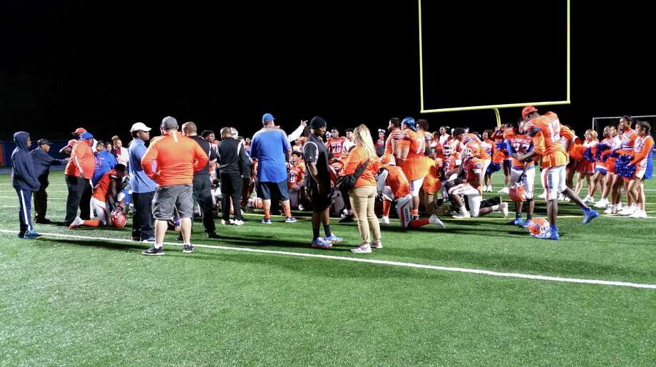 Bloomfield huddles after a 48-0 home win over Hillhouse at Phil Rubin Stadium on Sept. 27, 2019. Photo: Michael Fornabaio / Hearst Connecticut Media