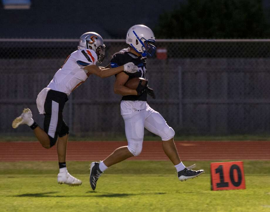 Trinity's George Philipps is pushed out of bounds by Sanderson's Jacobi Campos on Friday, Sept. 27, 2019 at Coombes Field. Photo: Jacy Lewis/Reporter-Telegram