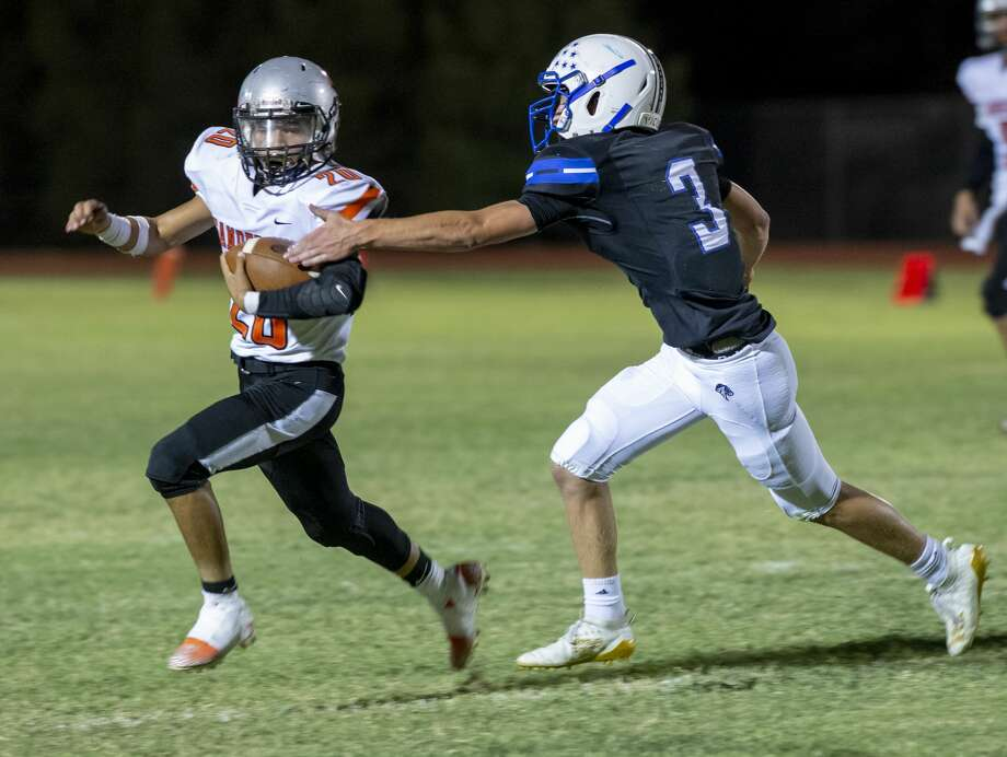Trinity's Grant Higgins (3) reaches for Sanderson's Alonzo Lopez on Friday, Sept. 27, 2019 at Coombes Field. Photo: Jacy Lewis/Reporter-Telegram