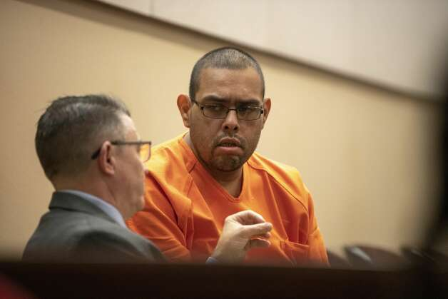 Christopher Moreno a former SAISD bus driver accused of murder in the hit-and-run death of Cynthia Gomez in January, is seeking to have his bail reduced speaks with his attorney Robert Maurer before a bond hearing on Friday, Sept. 20, 2019. Photo: Carlos Javier Sanchez / Contribu