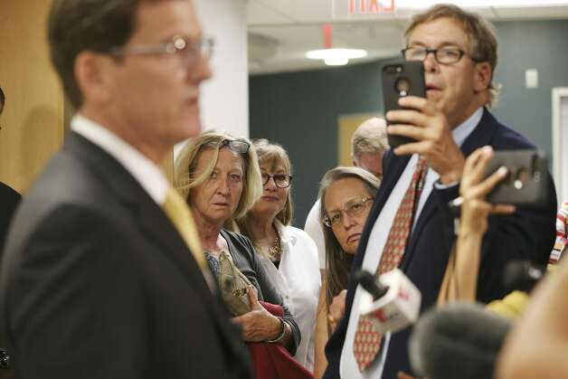 Center from left, Caye Powada, Liz Hilsdorf and Rebecca Broughton listen as attorney representing riverfront landowner, Doug Sutter, talks with the media outside a courtroom in Seguin, Texas, Monday, Sept. 16, 2019. Landowners brought a lawsuit against the Guadalupe Blanco River Authority to keep the authority from draining four lakes. The two parties reached an agreement on Monday. The accord prevents the authority from draining four lakes. The accord will keep the public from the lakes for up to 60 days to determine possible danger areas. It also keeps the authority from draining the lakes until a trial, set for Oct. 5, 2020, determines what actions should be taken. Photo: Jerry Lara/Staff Photographer
