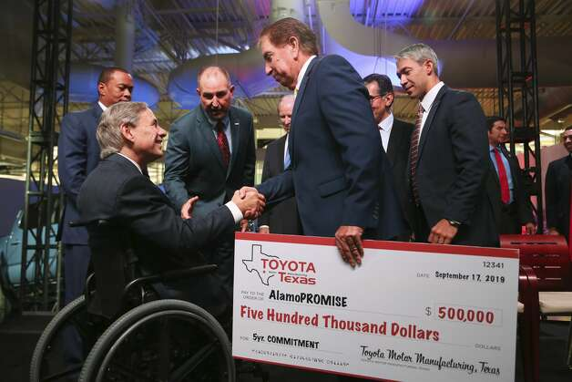 Alamo Colleges District Board of Directors Vice-President Joe Alderete, Jr. shakes hands with Texas Gov. Greg Abbott after at an event announcing a $391 million expansion at the San Antonio Toyota plant, Tuesday, Sept. 17, 2019. The district's AlamoPROMISE program will received a $500,000 commitment from Toyota. Photo: Jerry Lara/Staff Photographer