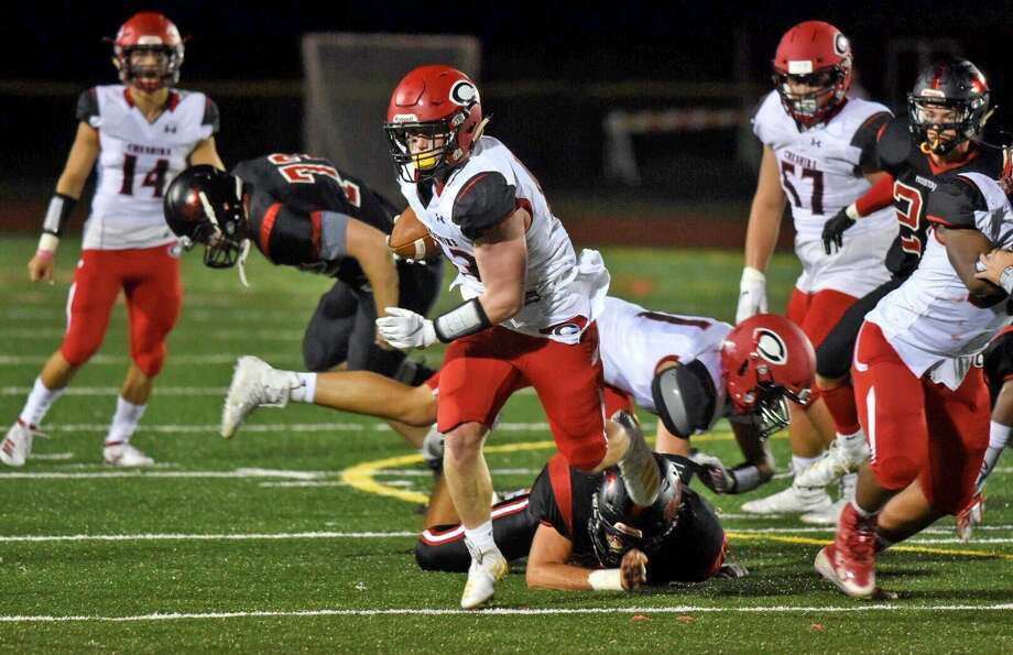 Cheshire's Jake McAlinden breaks free for a touchdown during a football game between Cheshire and Warde in Fairfield on Friday, Sept. 27, 2019. Photo: David Stewart / Hearst Connecticut Media / Connecticut Post