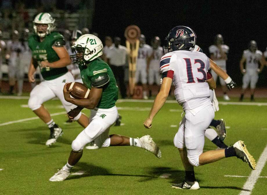 TWCA running back Dane Jackson (21) maneuvers around the Bay Area defense during a District 4-3A game Friday, September 27, 2019 at The Woodlands Christian Academy in The Woodlands. Photo: Cody Bahn, Houston Chronicle / Staff Photographer / © 2019 Houston Chronicle