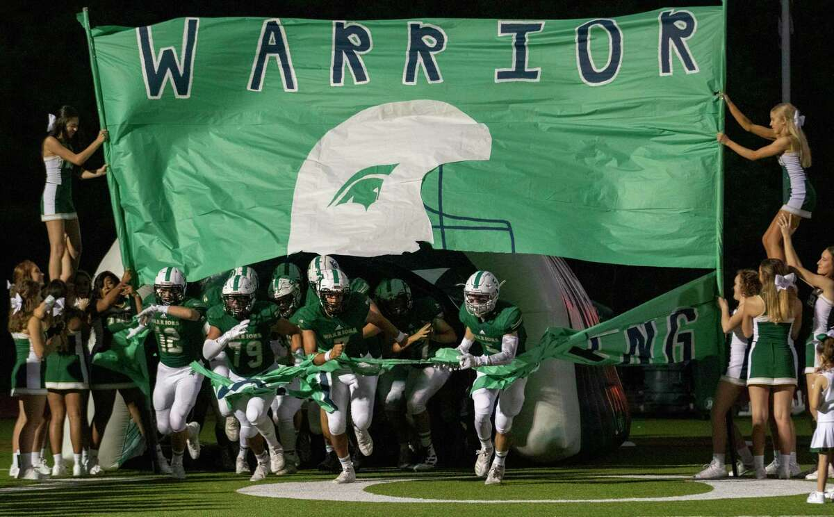 TWCA Warriors take the field before a District 4-3A game Friday, September 27, 2019 at The Woodlands Christian Academy in The Woodlands.