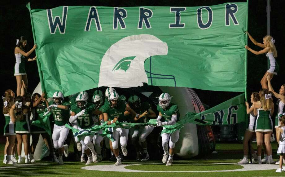 TWCA Warriors take the field before a District 4-3A game Friday, September 27, 2019 at The Woodlands Christian Academy in The Woodlands. Photo: Cody Bahn, Houston Chronicle / Staff Photographer / © 2019 Houston Chronicle