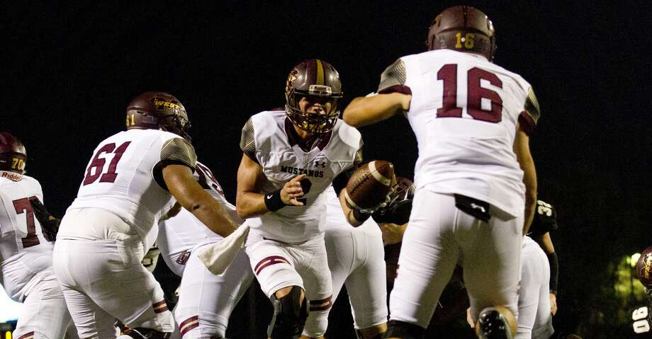 PHOTOS: Week 5 of high school football Magnolia West quarterback Tristan Brady (2) hands off to running back Nick Joseph (16) in the endzone during the third quarter of a non-district high school football game at Guy K. Traylor Stadium, Saturday, Sept. 14, 2019, in Rosenberg. Joseph was stopped in the endzone by Foster for a safety. Photo: Jason Fochtman/Staff Photographer
