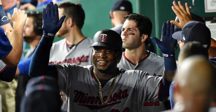 KANSAS CITY, MISSOURI - SEPTEMBER 27:  Miguel Sano #22 of the Minnesota Twins celebrates his two-run home run with teammates in the second inning against the Kansas City Royals at Kauffman Stadium on September 27, 2019 in Kansas City, Missouri. (Photo by Ed Zurga/Getty Images) Photo: Ed Zurga/Getty Images