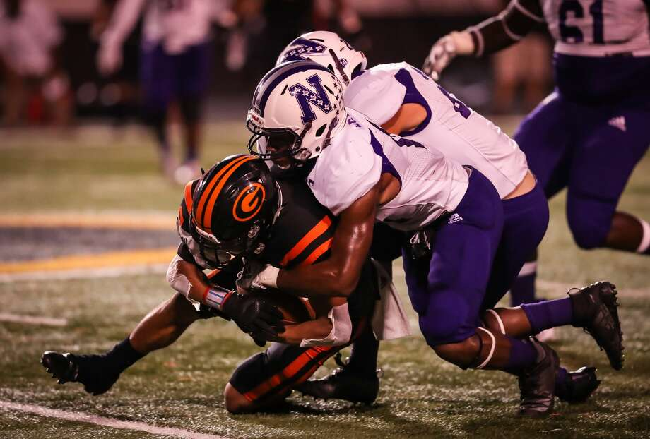 Dominique Seastrunk and Robbie Phillips making the tackle against Gilmer. Photo: Heather Foster/ Special To The Enterprise