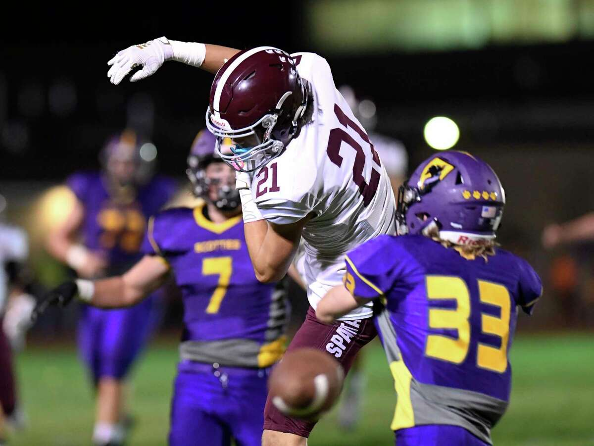 Photos from Week 4: Burnt Hills-Ballston Lake's Logan Stubblebine (21) can't make the catch against Ballston Spa defender Erik Gottmann (33) during a Section II high school football game in Ballston Spa, N.Y., Friday, Sept. 27, 2019. (Hans Pennink / Special to the Times Union)