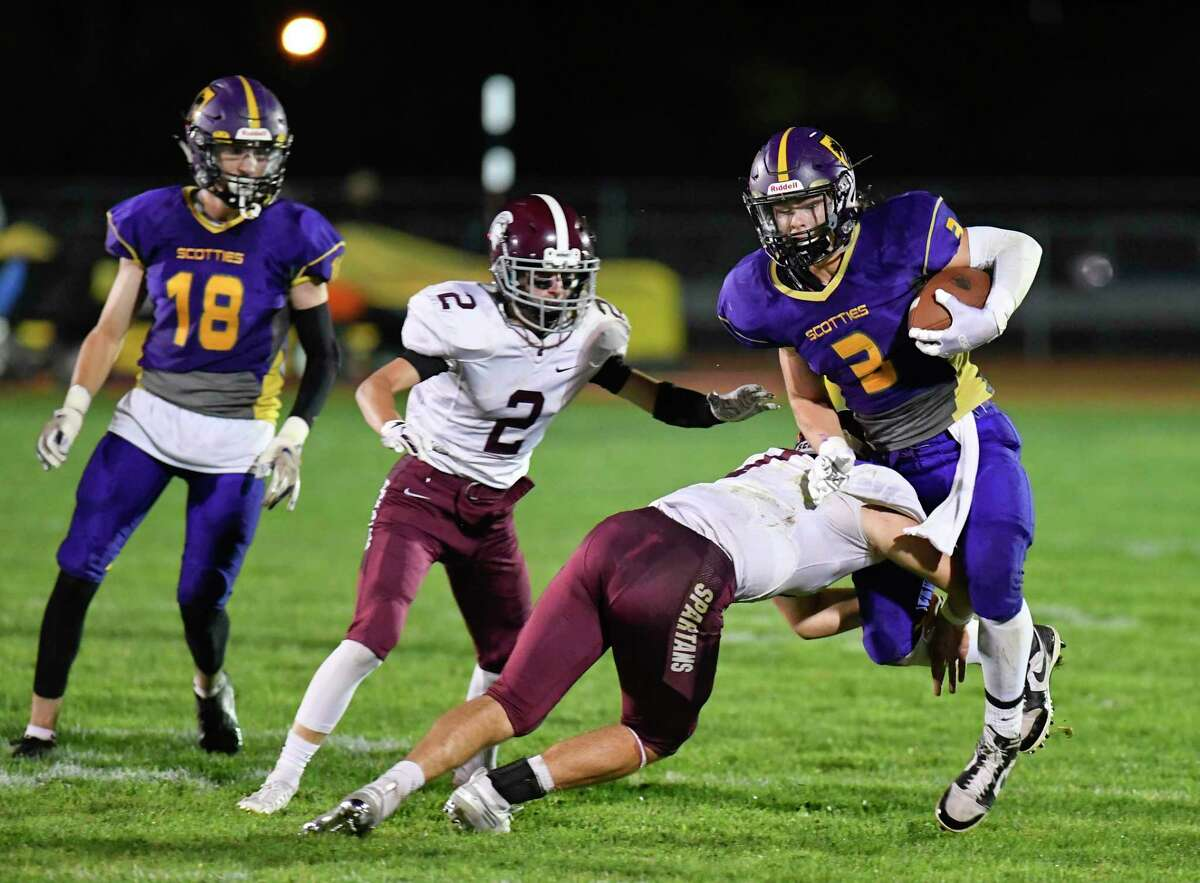Ballston Spa's James Prastio Jr. (3) runs the ball against Burnt Hills-Ballston Lake defenders during a Section II high school football game in Ballston Spa, N.Y., Friday, Sept. 27, 2019. (Hans Pennink / Special to the Times Union)