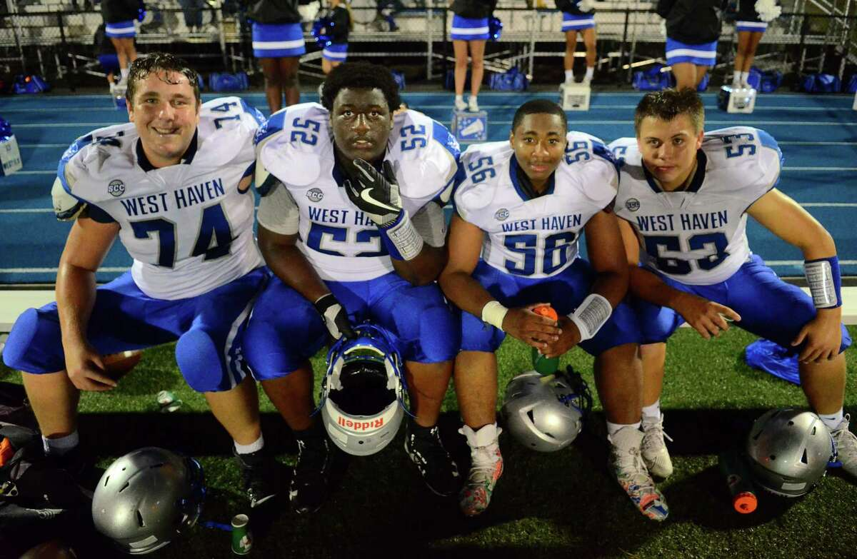 West Haven linemen Joseph Hawkins (74), KyshawnTogba (52), Paul Williams (56) -- who all return as starters in 2021 -- pose alongsidesince-graduated Kyle Tompkins (53) during a game at Newtown,Sept. 27, 2019.