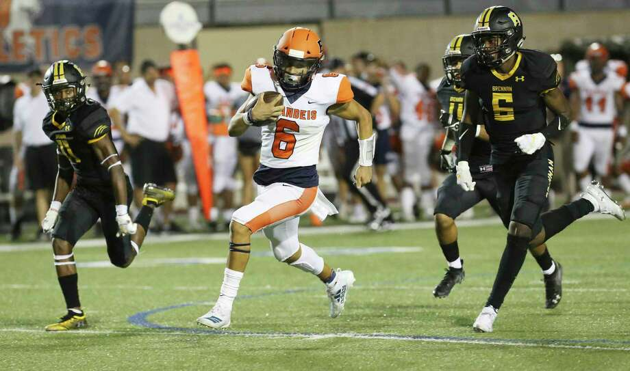 Brandeis quarterback Jordan Battles (06) breaks out a long yardage run near the end of the first quarter against Brennan's Ticoroyo Battles (11), Justino Escobar (04) and Donovan Dreighton (06) to set up a second quarter touchdown during their game at Farris Stadium on Friday, Sept. 27, 2019. (Kin Man Hui/San Antonio Express-News) Photo: Kin Man Hui, Staff / Staff Photographer / ©2019 San Antonio Express-News
