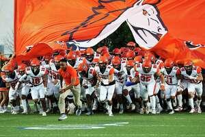 The Brandeis Broncos take the field for the game against Brennan at Farris Stadium on Friday, Sept. 27, 2019. (Kin Man Hui/San Antonio Express-News)