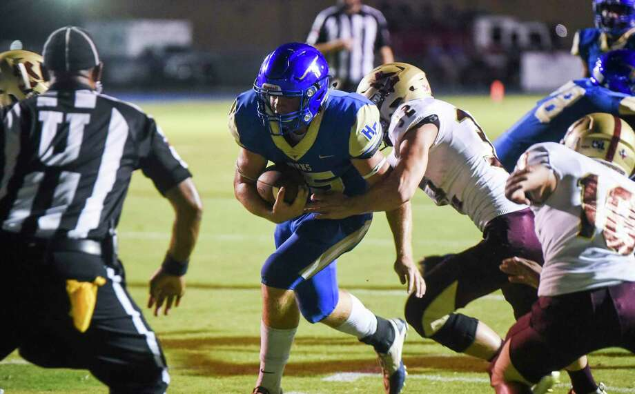 Hamshire-Fannett's Kyle Saurage runs the ball into the end zone for a touchdown during the first half of the game at Longhorn Stadium in Hamshire Friday night. Photo taken on Friday, 09/27/19. Ryan Welch/The Enterprise Photo: Ryan Welch, Beaumont Enterprise / The Enterprise / © 2019 Beaumont Enterprise