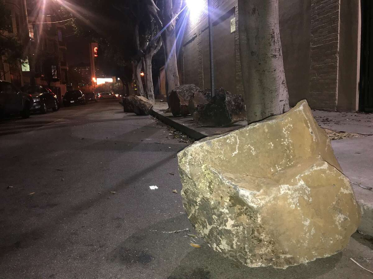 Someone -- or several someones -- rolled six of the 24 boulders that a group of San Francisco residents had placed on the Clinton Park alley sidewalk, supposedly to deter homeless people from congregating there.