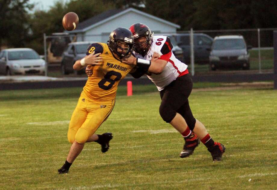 The North Huron Warriors suffered their first loss of 2019 against visiting Kingston on Friday night. The Cardinals topped the Warriors, 34-20. Photo: Mark Birdsall/Huron Daily Tribune