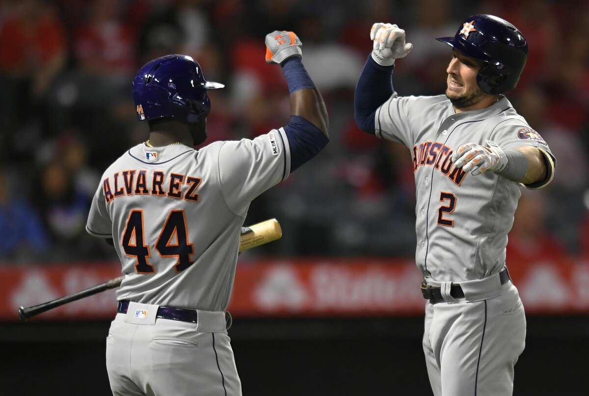 ANAHEIM, CA - SEPTEMBER 27: Yordan Alvarez #44 of the Houston Astros congratulates Alex Bregman #2 on his solo home run against the Los Angeles Angels in the first inning at Angel Stadium of Anaheim on September 27, 2019 in Anaheim, California. (Photo by John McCoy/Getty Images)