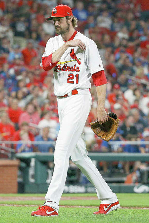 Cardinals relief pitcher Andrew Miller walks toward the dugout after being relieved in the seventh inning of Friday's game against the Cubs at Busch Stadium. Photo: Scott Kane | AP Photo