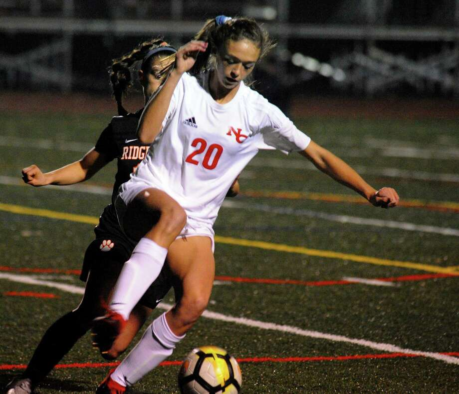 New Canaan's Emma Schuh, shown in action during last year's FCIAC final, scored the Rams' first goal in a 2-0 win over Wilton Friday night at Dunning Field. Photo: Christian Abraham / Hearst Connecticut Media / Connecticut Post