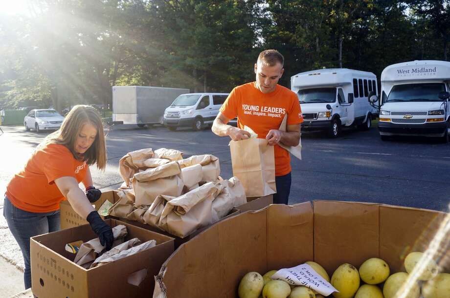 Margaret Doan and Alex Bank of Young Leaders United volunteer at a surplus food distribution event at West Midland Family Center. Photo: Photo Provided/United Way Of Midland County