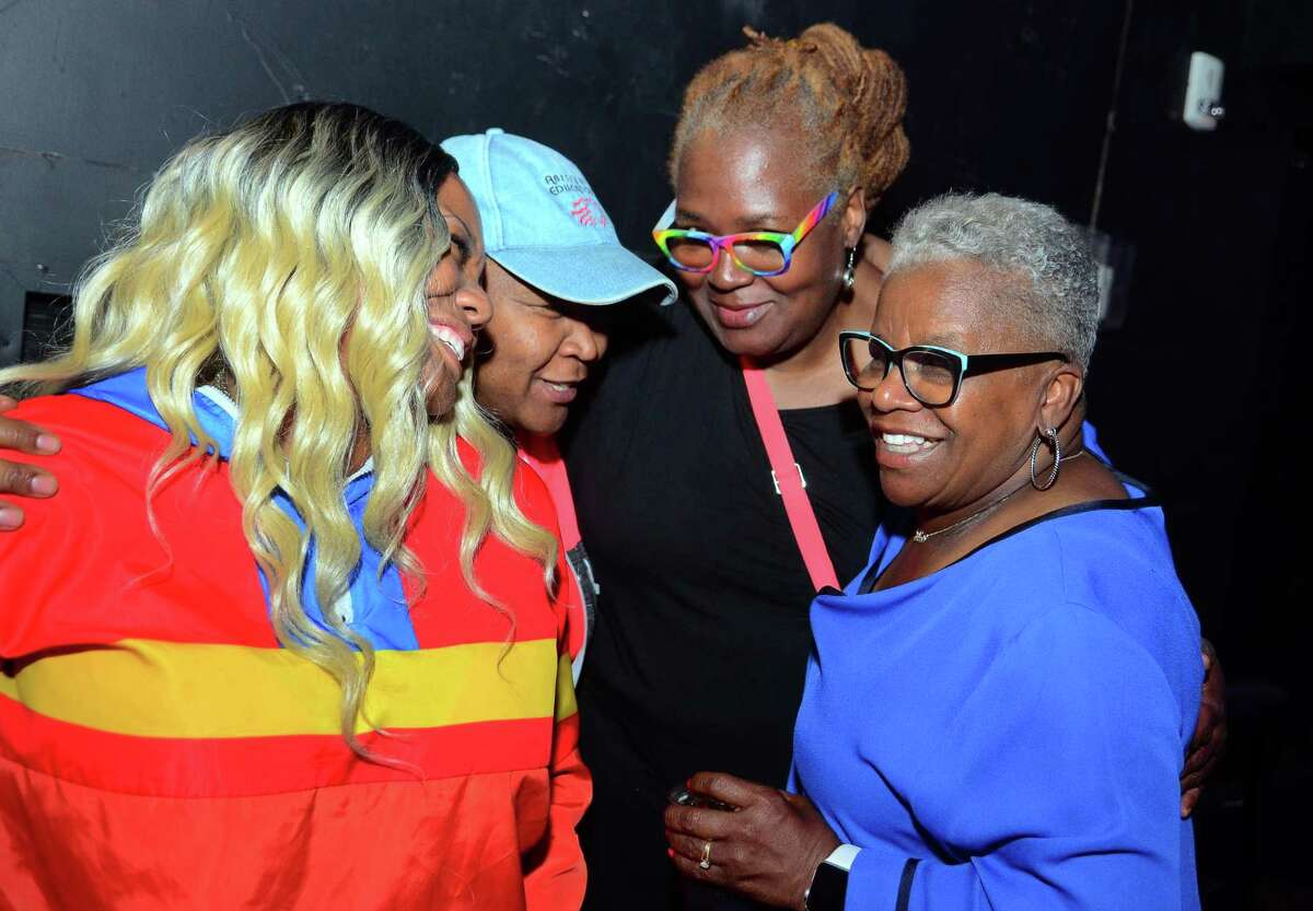 Supporters Karen Soares-Robinson, left, Dawn Spearman and Debbi Sims greet State Senator Marilyn Moore, right, after Moore unofficially lost her primary challenge against Mayor Joe Ganim during her campaign party at the Bijou Theater in Bridgeport, Conn., on Tuesday Sept. 10, 2019. Absentee ballots are holding up the final results.