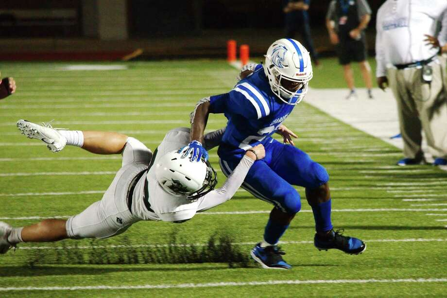 Clear Springs' Kaleb Hymes (22) tries to break the tackle of Clear Falls' Cole Bailey (28) Friday at Challenger Columbia Stadium. Photo: Kirk Sides / Staff Photographer / © 2019 Kirk Sides / Houston Chronicle