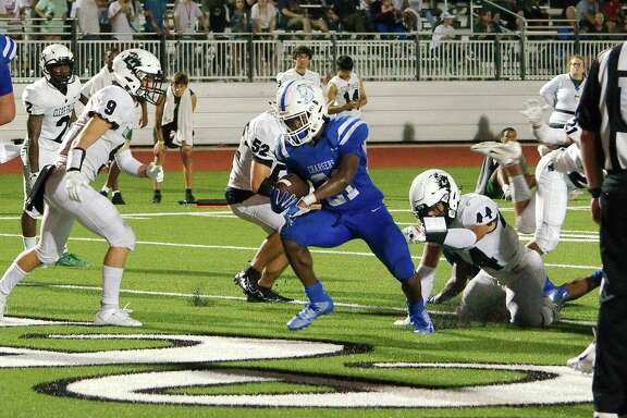 Clear Springs' Ky Woods (21), shown here against Clear Falls, scored five touchdowns and rushed for 213 yards against Clear Brook Friday night.