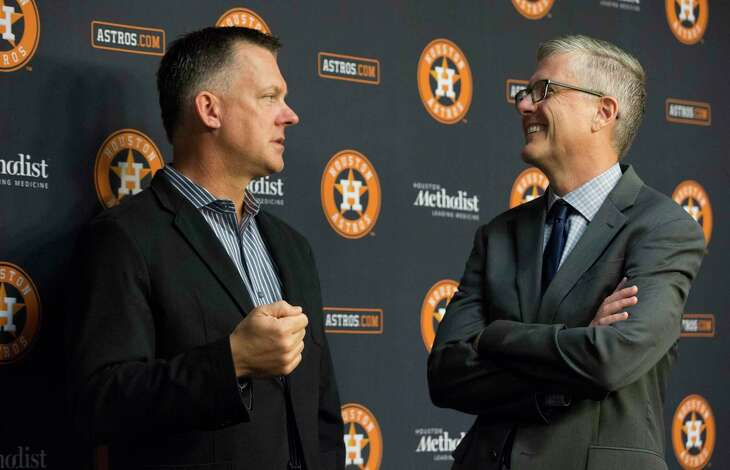 Astros manager A.J. Hinch and general manager Jeff Luhnow share a lighter moment earlier in the season.
