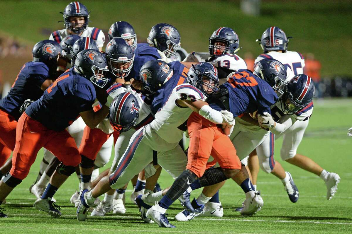 Milton Jones (27) of Seven Lakes is tackled by Kobee Madriz (23) of Tompkins during the second quarter of a 6A Region III District 19 football game between the Seven Lakes Spartans and the Tompkins Falcons on Friday, September 27, 2019 at Rhodes Stadium, Katy, TX.