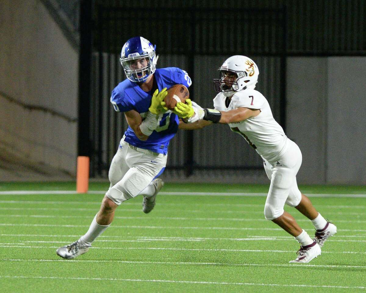 Braden Hay (20) of Taylor makes an interception intended for Marcus Aguilar (7) of Deer Park during the fourth quarter of a non-district football game between the Katy Taylor Mustangs and the Deer Park Deer on Saturday, September 14, 2019 at Legacy Stadium, Katy, TX.