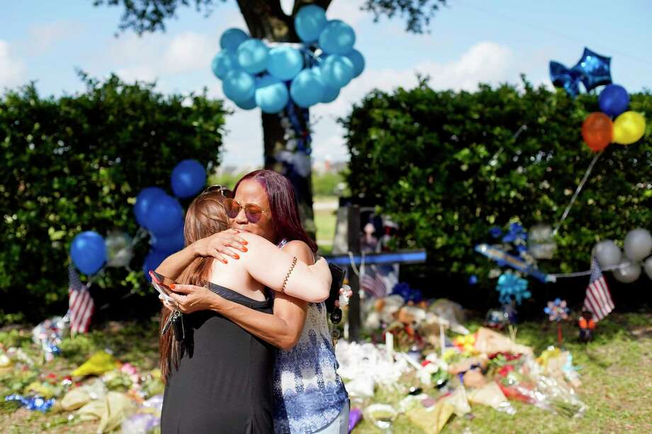 "Sherry Johnson, right, hugs another mourner at a makeshift memorial for Deputy Sandeep Dhaliwal, who was shot and killed Friday after a routine traffic stop on Willancy Court near Cypress on Saturday, Sept. 28, 2019. Johnson, who lives in the area first met Deputy Dhaliwal after Harvey. ""It was my first hurricane and I was just sitting outside, so confused, he came up and comforted me, gave me helpful phone numbers and he had checked up on me ever since."" Photo: Elizabeth Conley, Houston Chronicle / Staff Photographer / © 2018 Houston Chronicle"