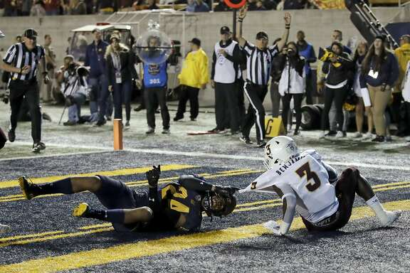 Arizona State's Eno Benjamin (3) scores a touchdown past California's Camryn Bynum (24) in the first half of an NCAA college football game Friday, Sept. 27, 2019, in Berkeley, Calif. (AP Photo/Ben Margot)