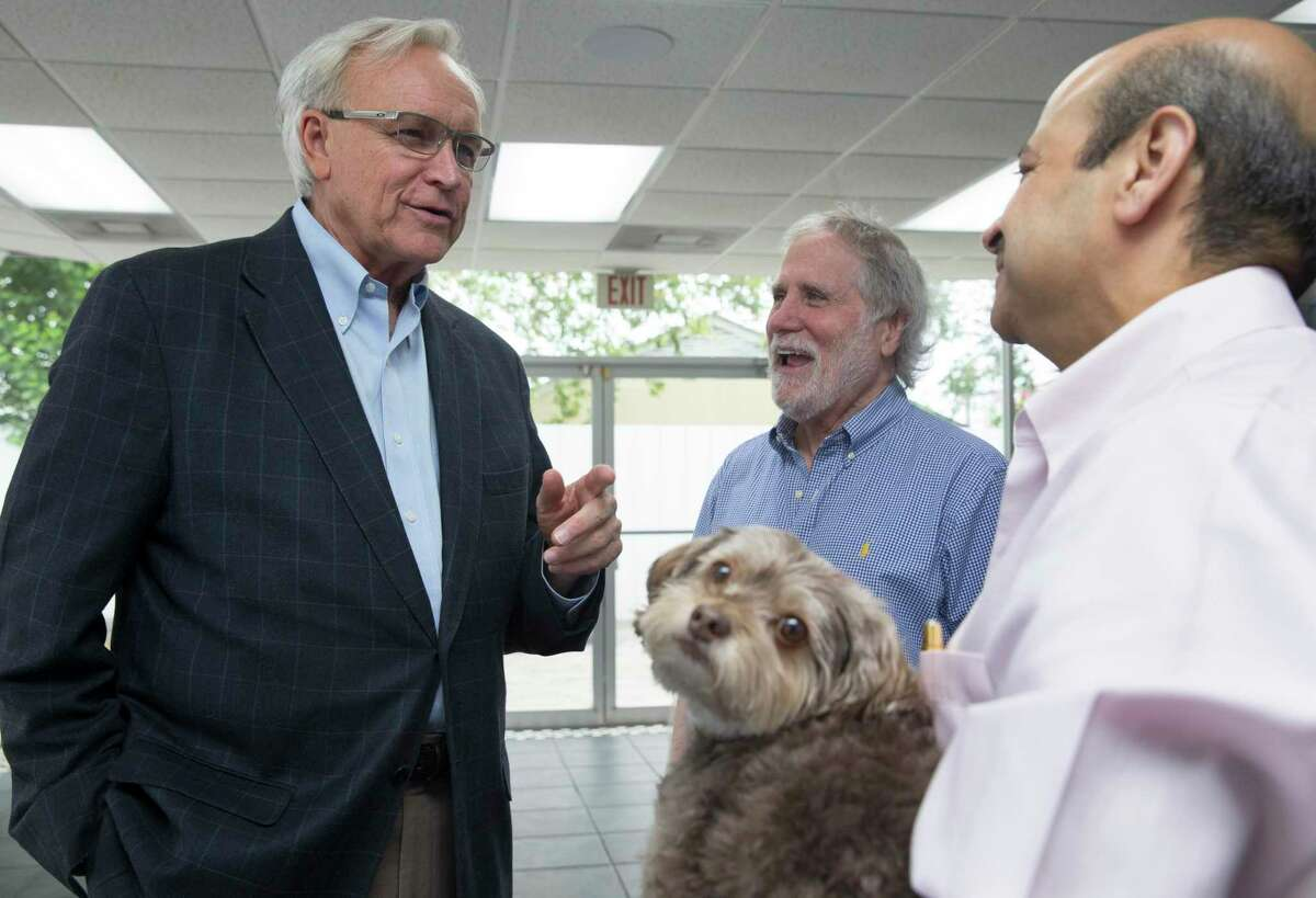 Bill King, left, who is returning to the campaign trail after narrowly losing to Mayor Sylvester Turner four years ago, talks to his supporters during a fundraiser at IT Dimensions Inc. on Friday, Sept. 27, 2019, in Houston.