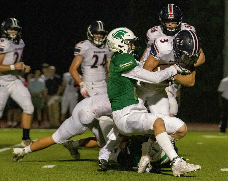TWCA defensive back Caedmon Parker (15) brings down Bay Area Christian running back Wesley Barnes (3) during a District 4-3A game Friday at The Woodlands Christian Academy in The Woodlands. Photo: Cody Bahn, Houston Chronicle / Staff Photographer / © 2019 Houston Chronicle