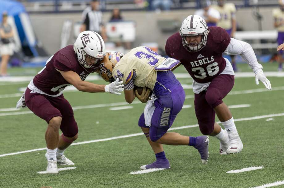 Lee's Anthony Gonzalez and Charlie Gonzales (36) tackle  San Benito's Tony Torres (34) on Saturday, Sept. 28, 2019 at Grande Communications Stadium. Photo: Jacy Lewis/Reporter-Telegram